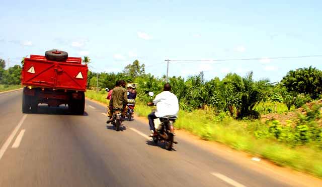 Motos passing a truck