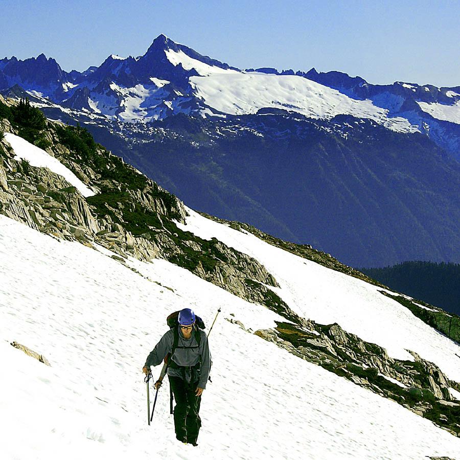 Karl side-hilling with Eldorado Peak in the distance